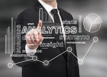 businessman touching analytics symbol on black background Stock Photo