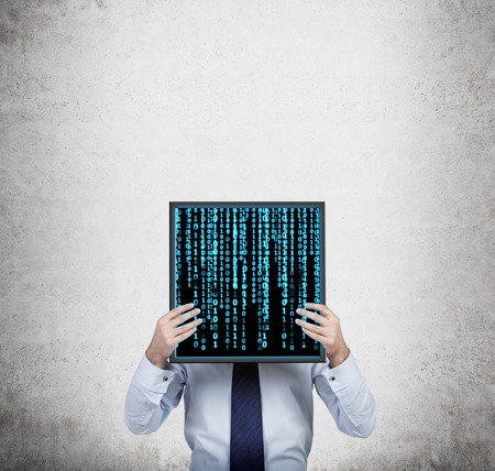 matrix code: businessman holding plasma panel with matrix code
