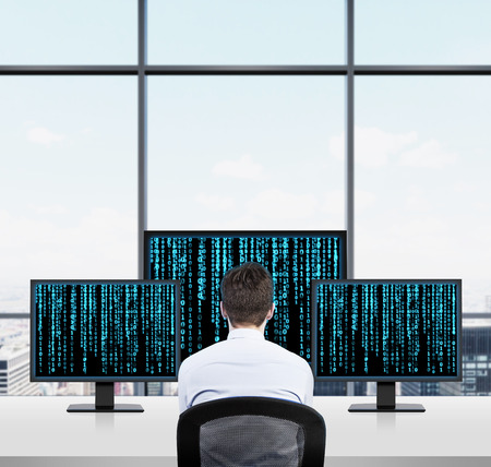 hacker: businessman looking to three screen with matrix background