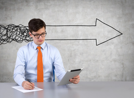 drawing arrow: Businessmen working in office with drawing arrow on wall