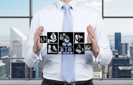 financial symbols: businessman holding drawing business symbol in hand Stock Photo
