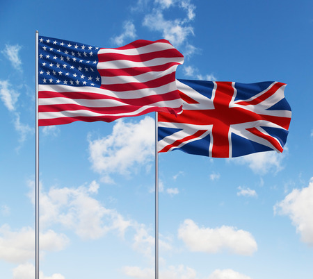 two flags of usa and United Kingdom  on a sky background Banco de Imagens