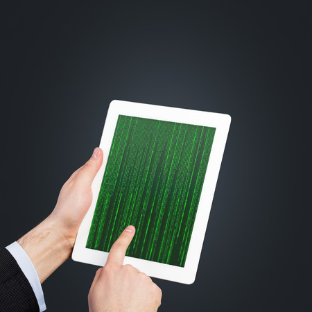 matrix code: hand holding touch pad with matrix code
