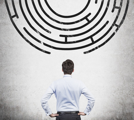 success strategy: businessman looking to out way of the labyrinth Stock Photo