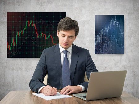 Businessmen working in office with graph on wall photo