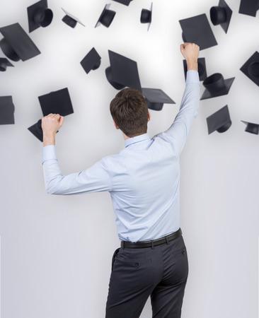 alumnus: happy businessman and falling hat bachelor