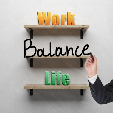work life balance: hand grawing on shelf business text concept Stock Photo