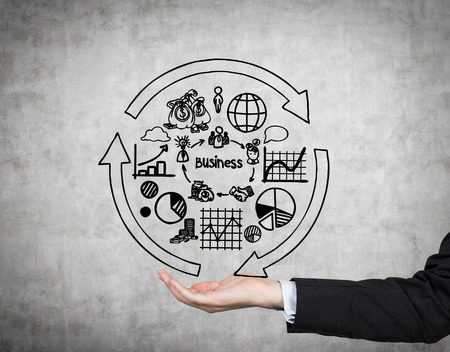 ideas risk: hand holding business arrows and charts