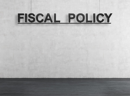 domestic policy: room with  fiscal policy text on wall Stock Photo