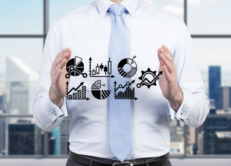 businessman holding charts and graphs, close up Stock Photo