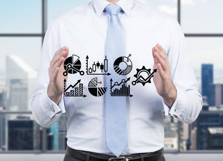 businessman holding charts and graphs, close up Standard-Bild