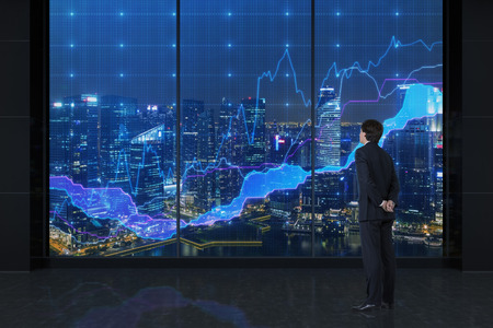 üzletember keres a grafikonok és tekintse meg a város Stock fotó