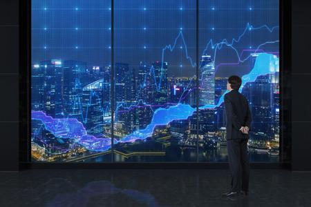 ビジネスマンのグラフおよびビューを市に