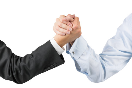 arm in arm: businessmen engaged in arm wrestling Stock Photo