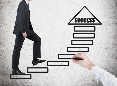 drawing arrow: businessman walking on drawing arrow in success
