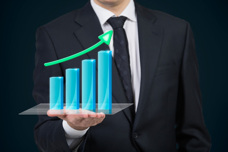 businessman holding stock chart with arrow Stock Photo