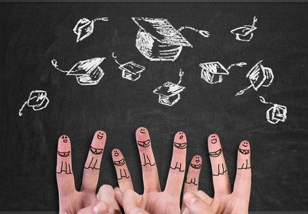 the alumnus: happy group of finger smileys with bachelor hat Stock Photo