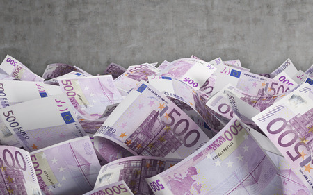 500 euro bills on a conctere wall background photo