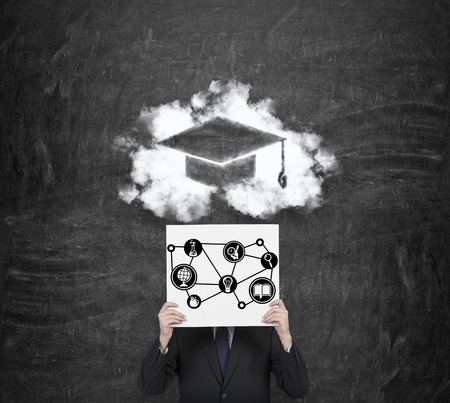 alumnus: businessman holding poster with drawing education symbol Stock Photo