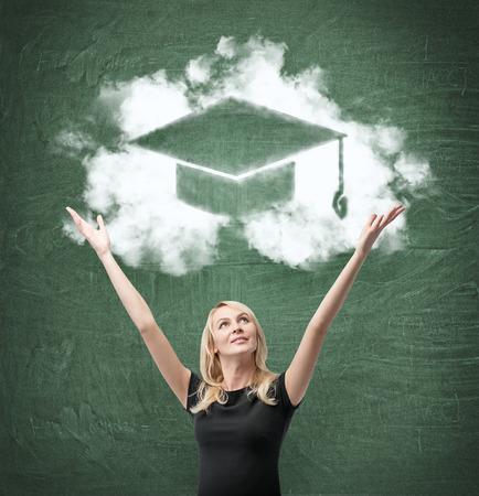 alumnus: happy woman with drawing bachelor hat on green  chalk board,