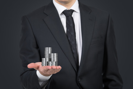 silver coins: Businessman handing silver coins on white background