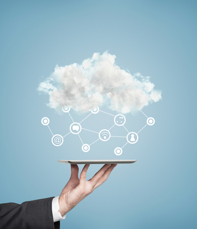 cloud: Hand holding touch pad with cloud, social media concept Stock Photo