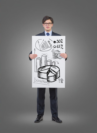 gripping bars: businessman holding poster with drawing chart Stock Photo