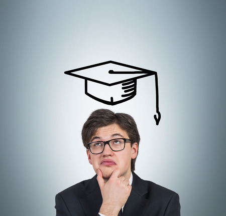 alumnus: student in drawing bachelor hat on a blue background