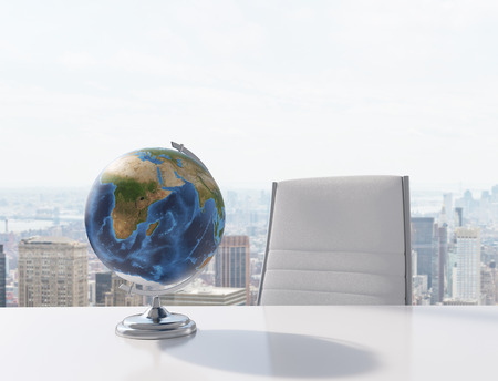 office lighting: globe on table in office, 3d render Stock Photo