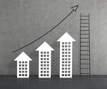 woden: drawing stock chart on gray concrete wall and ladder Stock Photo