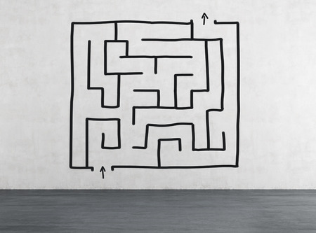 strategy decisions: drawing labyrinth on wall with way to success on wall Stock Photo