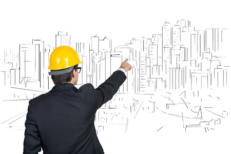 executive helmet: businessman in helmet pointing at drawing skyscraper Stock Photo