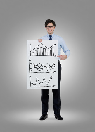 gripping bars: businessman holding placard with drawing graph Stock Photo