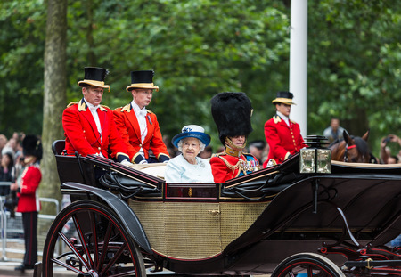 LONDON - JUNE 14: Queen Elizabeth II and Prince Philip seat on the Royal Coach at Queens Birthday Parade, also known as Trooping the Colour, on June 14, 2014 in London, England. Editorial