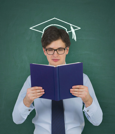 bachelor: student with drawing bachelor hat holding book Stock Photo