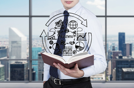 success risk: businessman holding book with business plan Stock Photo