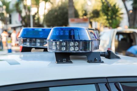 police lights: blue lights of police car, close up