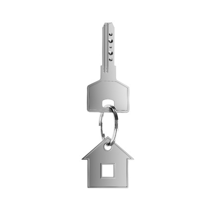 trinket: key with green trinket in form house on white background Stock Photo