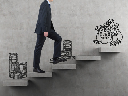 difficult journey: drawing money standing on stairs and walking businessman Stock Photo