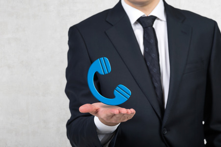 cellphone icon: businessman holding cellphone icon in hand