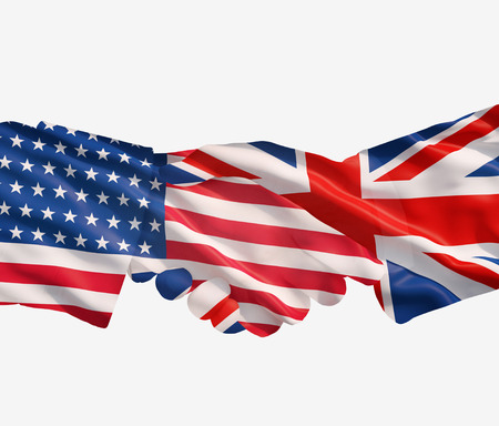 UK and US flags with a handshake on a white  Stock Photo