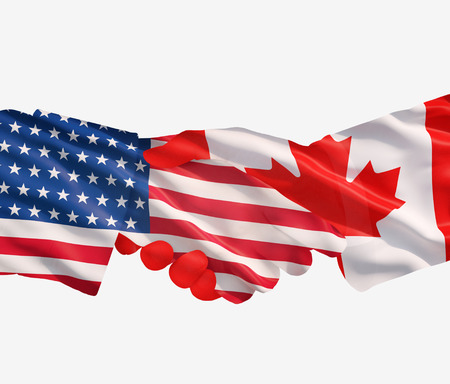 foreign nation: Representatives of the USA and Canada shake hands Stock Photo