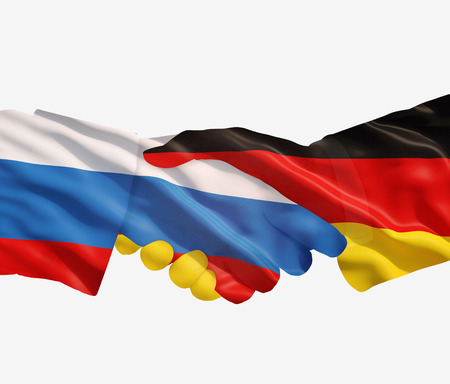 reach out: Germany and Russia reach out their hands Stock Photo