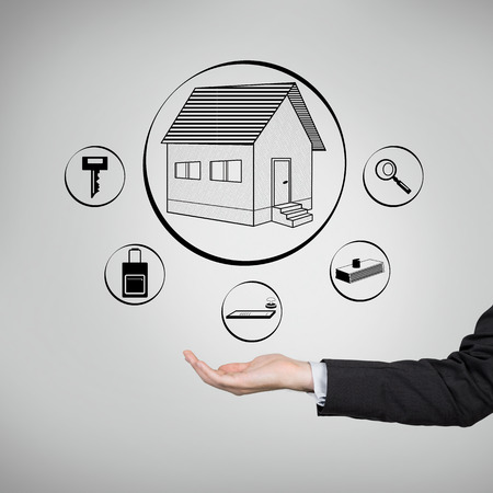 businessman hand holding drawing real estate icon photo