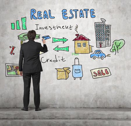 realtor: realtor drawing real estate concept on wall