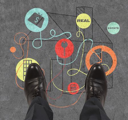 realtor: foot realtor standing on real estate symbol Stock Photo