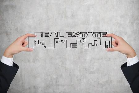 realtor: realtor holding real estate symbol