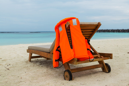 life jacket: life jacket on chair in tropical vacation