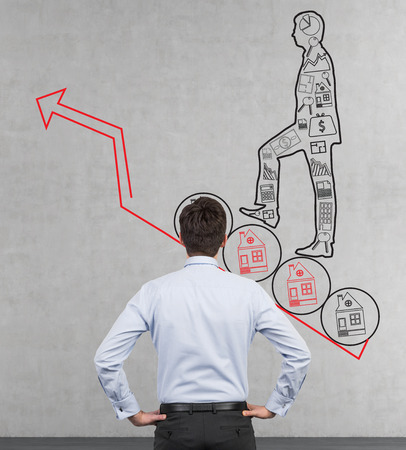 businessman looking at drawing man with business icons photo