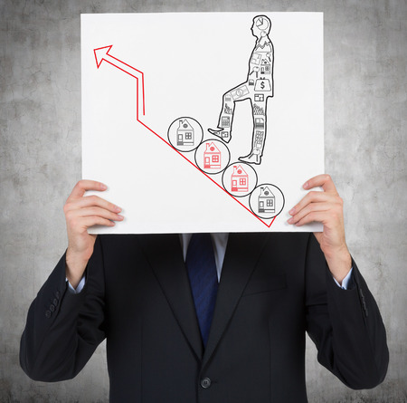 businessman holding poster wih drawing man walking on house photo